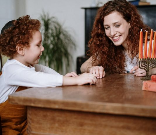 Mother and Son With a Menorah
